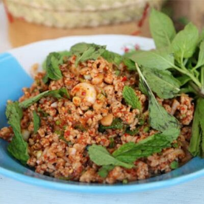 National Dish of Laos - sticky rice, larb, and tam mak hoong